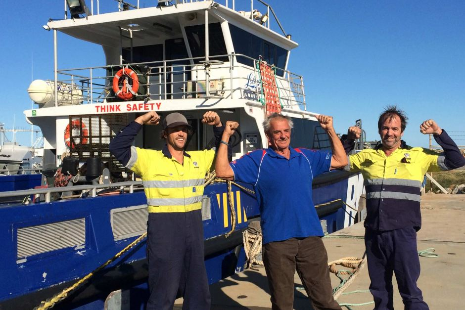 Deckhand Jesse Bailey (l) and boat master Lance Dennis rescued John Sanders (c) after his yacht started taking on water off WA's Gascoyne coast. 28 June 2015